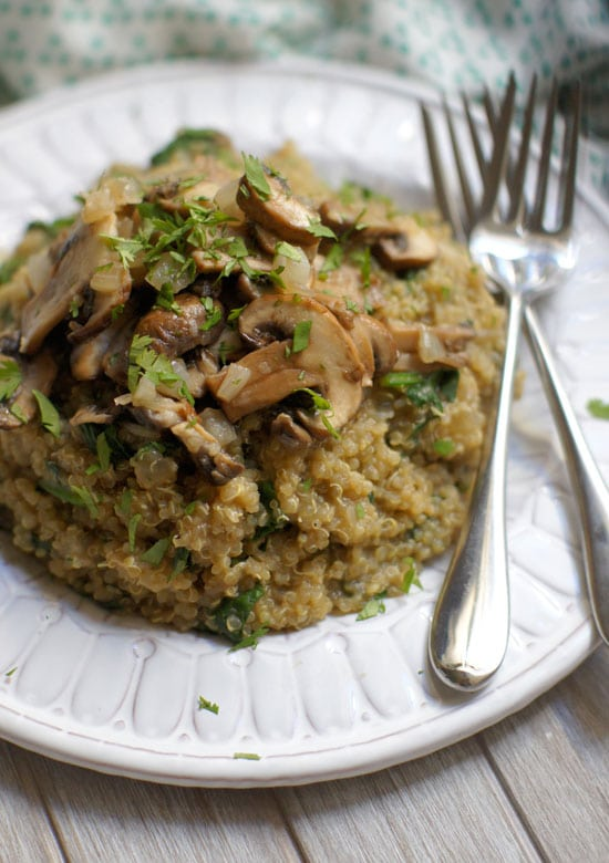 spinach and mushroom quinoa risotto on a plate