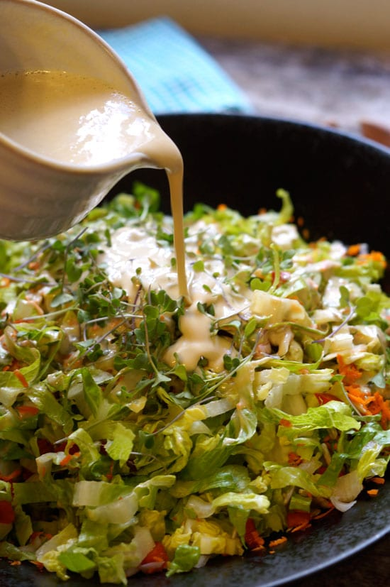 salad with creamy thai peanut dressing poured on top