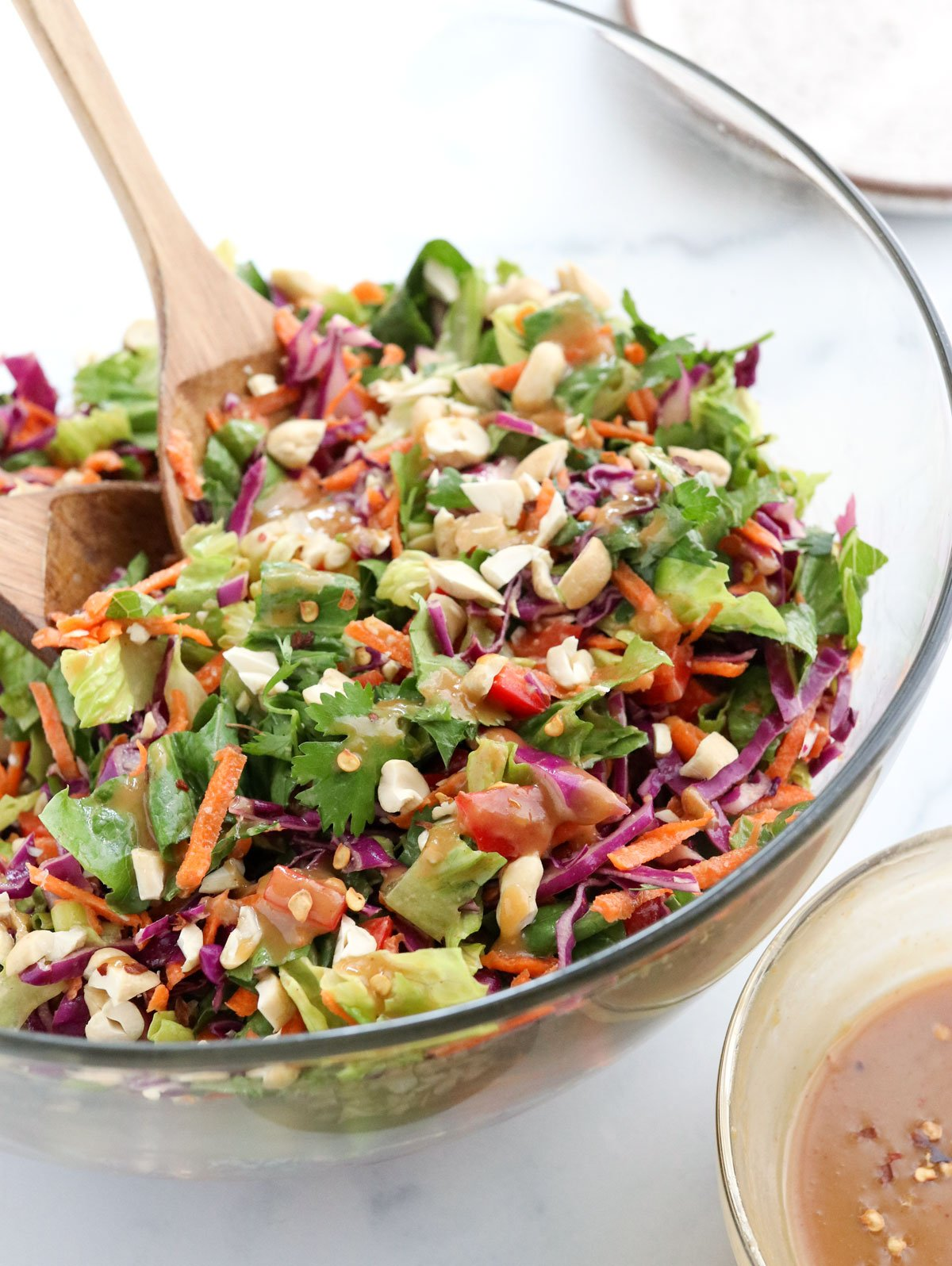 thai salad tossed in glass bowl