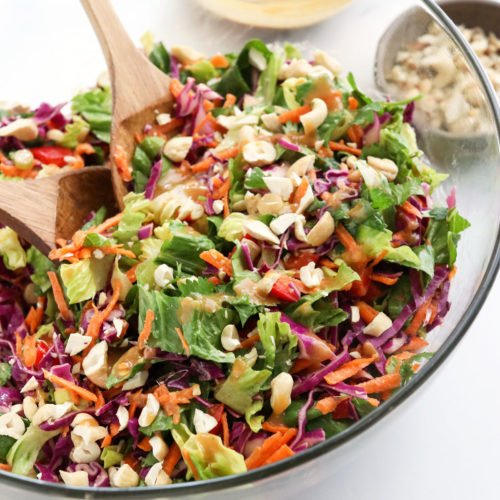 thai salad with peanut dressing in glass bowl