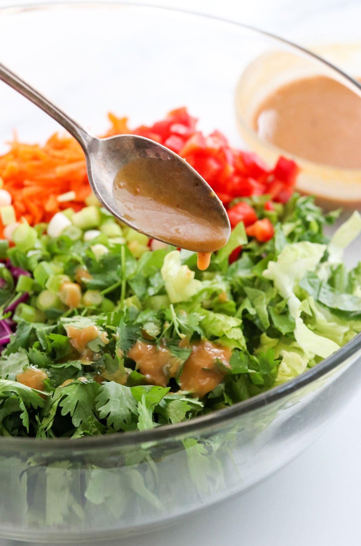 peanut salad dressing poured on salad