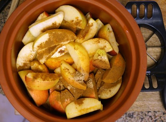 sliced apples in a slow cooker