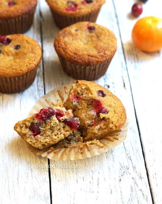 orange cranberry coconut flour muffins with one broken in half