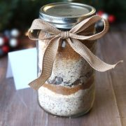 Cookie dry good ingredients in a mason jar with bow