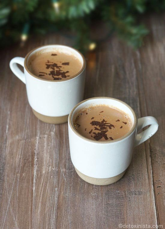 hot chocolate in two mugs with chocolate shavings on top