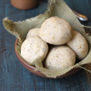 Paleo dinner rolls in small dish with burlap