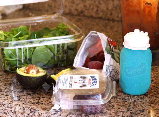 smoothie ingredients including avocado, spinach, dates, and frozen berries