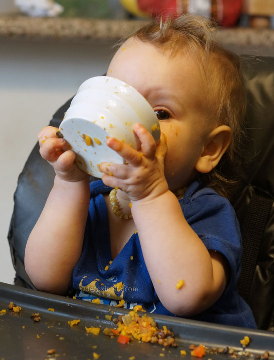toddler eating out of a small bowl