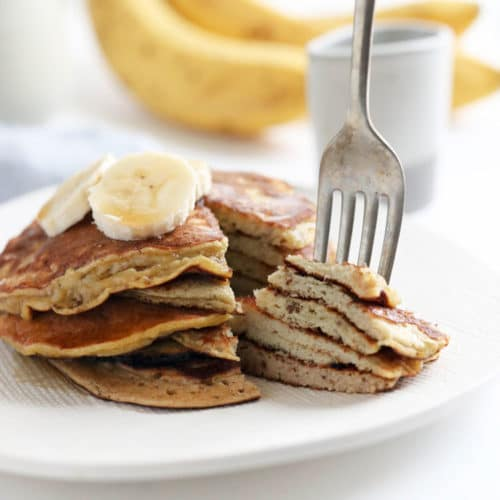 banana egg pancakes stack with fork