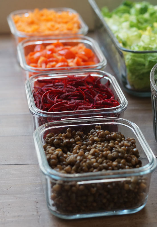 salad toppings in small glass containers