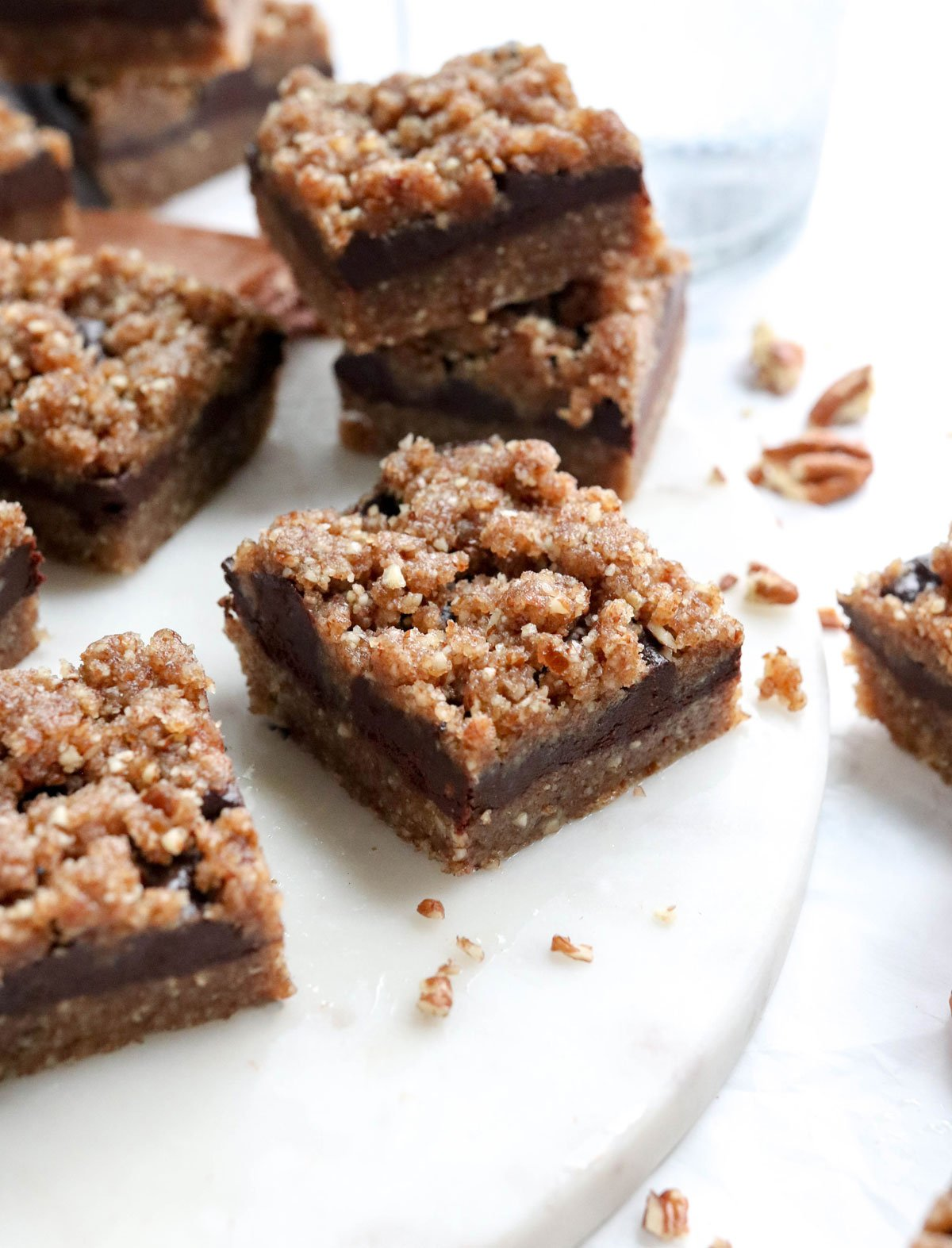 chocolate pecan pie bars on marble board