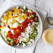 overhead vegetarian cobb salad with dressing