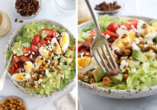finished cobb salad with dressing on top and fork