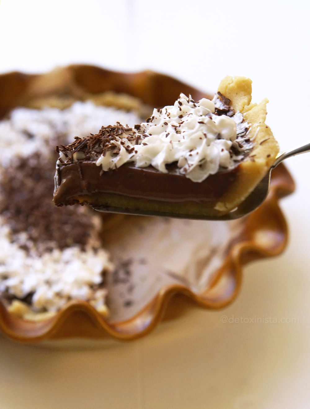 piece of french silk pie on a pie server