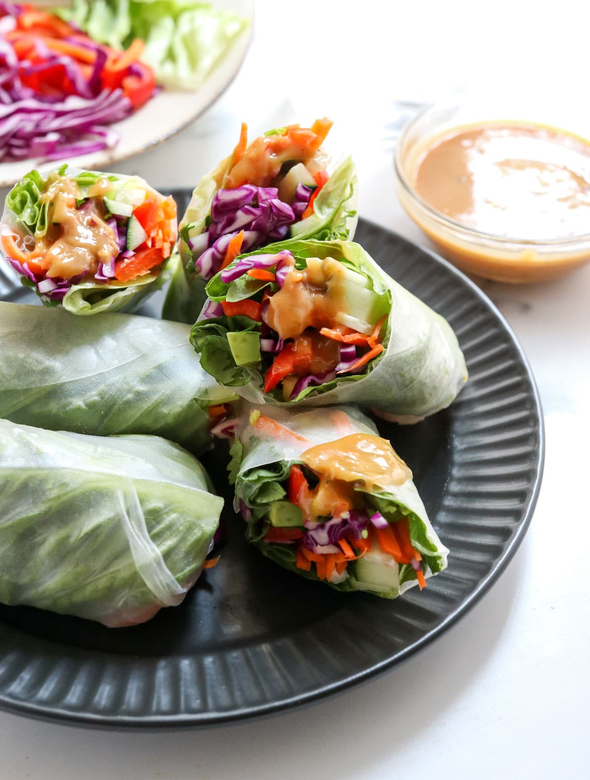 spring rolls with peanut sauce on top