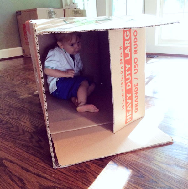 toddler in a cardboard box