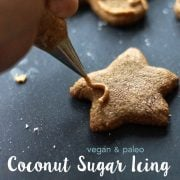 coconut sugar icing being pipped on cookie