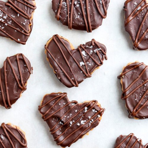 chocolate peanut butter hearts on parchment paper