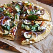 Gluten-free Mediterranean Chickpea Flour Pizza closeup