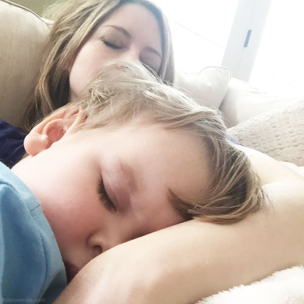 mom and toddler sleeping on a couch