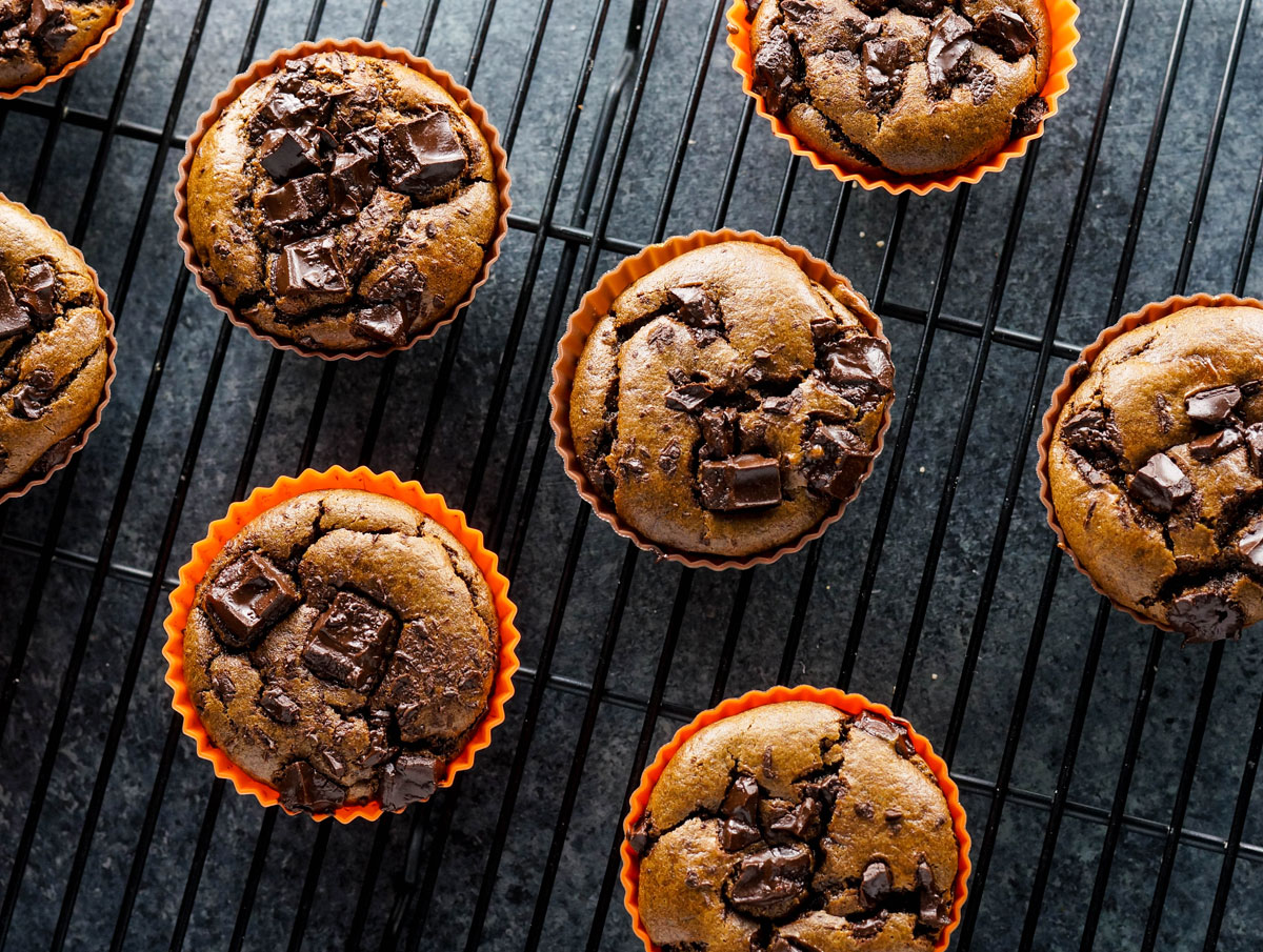 double chocolate pumpkin muffins on a cooling rack