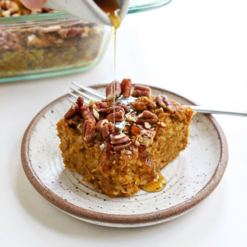 slice of pumpkin baked oatmeal with maple syrup