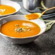 Vegan Creamy Pumpkin Tomato Soup with spoon