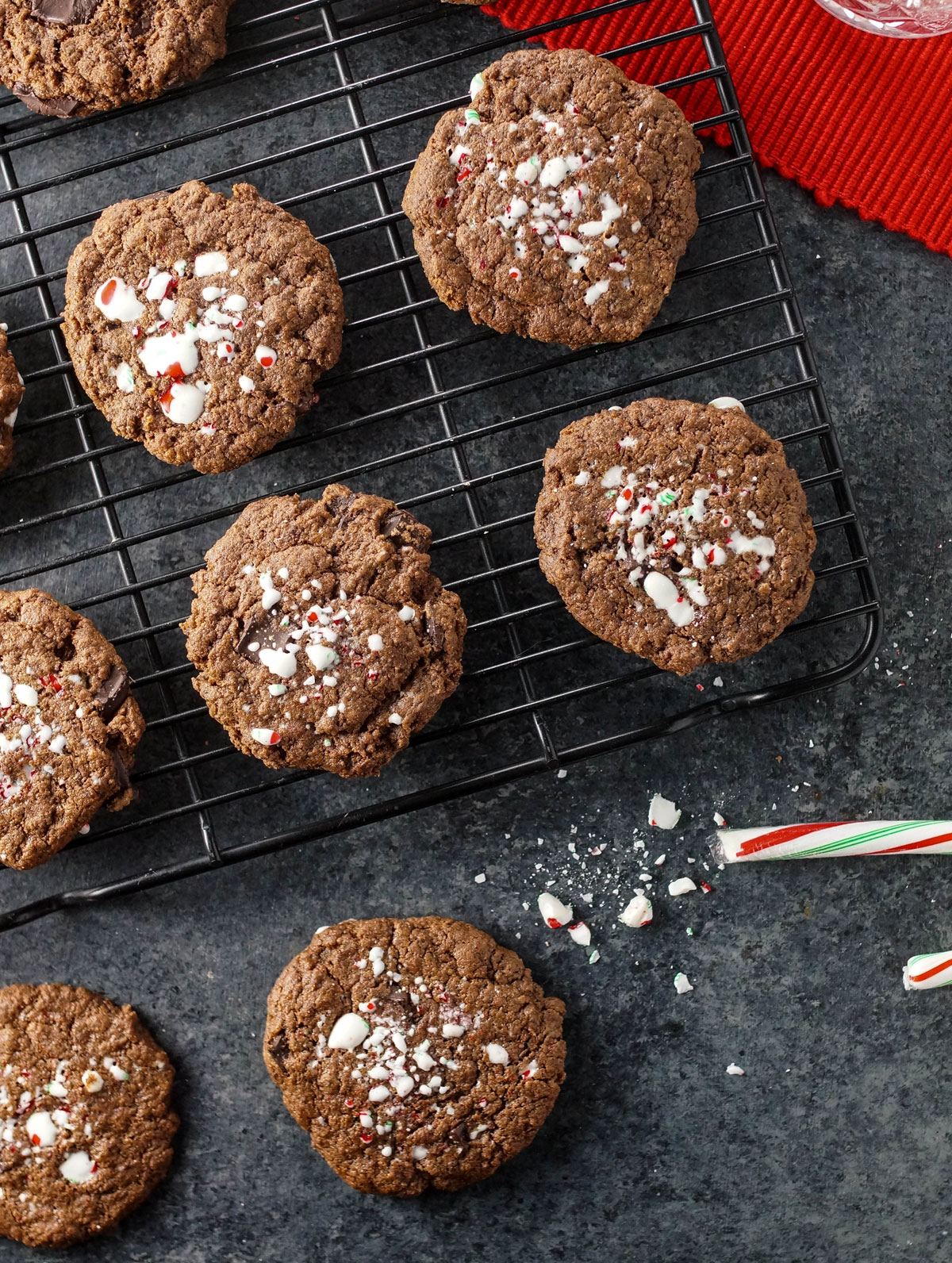 chocolate mint cookies on a cooling rack with candy cane sprinkled on top