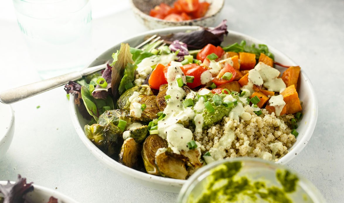 plate of roasted vegetable quinoa bowl
