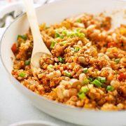 Healthy Creole-Style Cauliflower Rice Jambalaya in white bowl