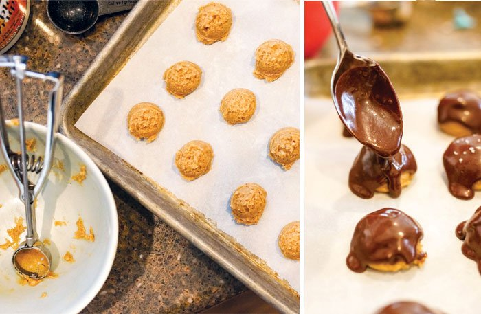 almond butter buckeyes with chocolate coating being poured on top with a spoon
