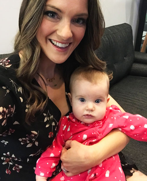 Megan holding baby girl in her arms