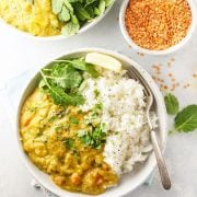 red lentil curry overhead with bowl of rice