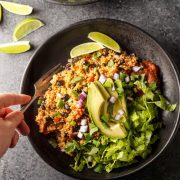 quinoa vegan burrito burrito bowl with lime overhead view