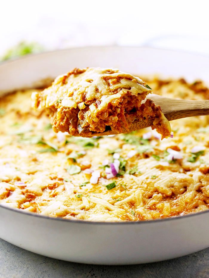scoop of mexican cauliflower casserole lifted up with a spoon