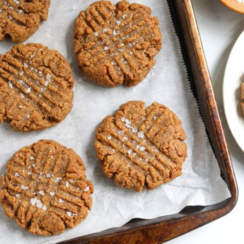 peanut butter date cookies on pan with salt