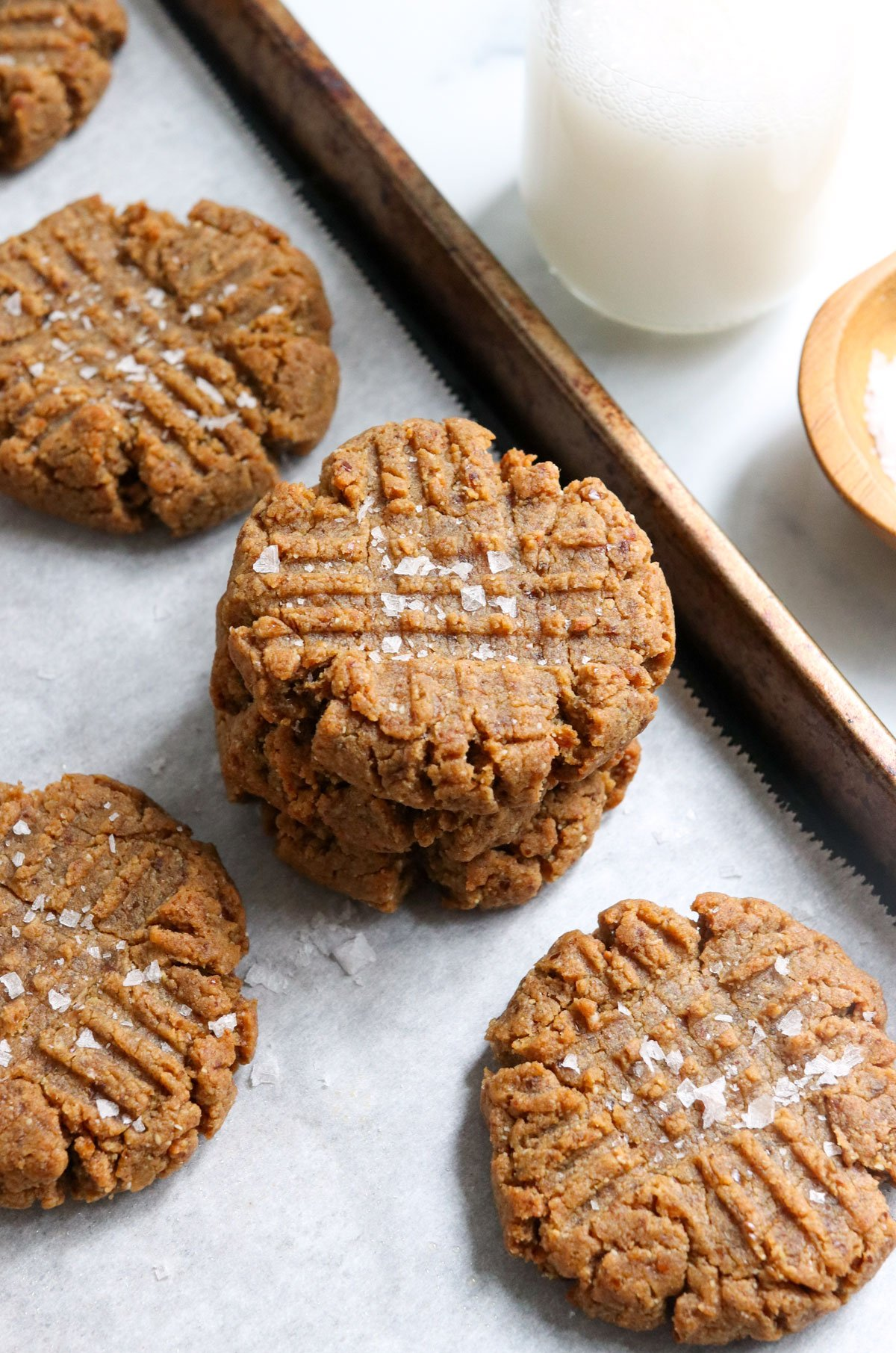 peanut butter cookies stacked on pan