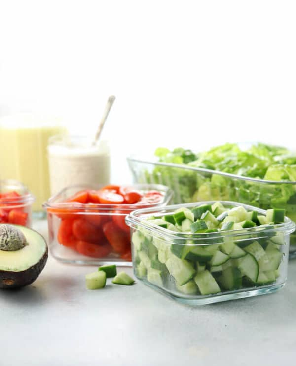 chopped salad ingredients stored in glass jars