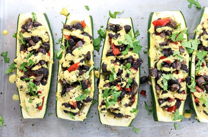 Vegan stuffed zucchini recipe detoxinista overhead picture of zucchini stuffed with black beans cheese sauce and cilantro forumfinder Image collections
