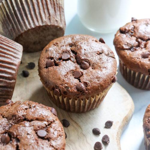 healthy chocolate zucchini muffins on cutting board