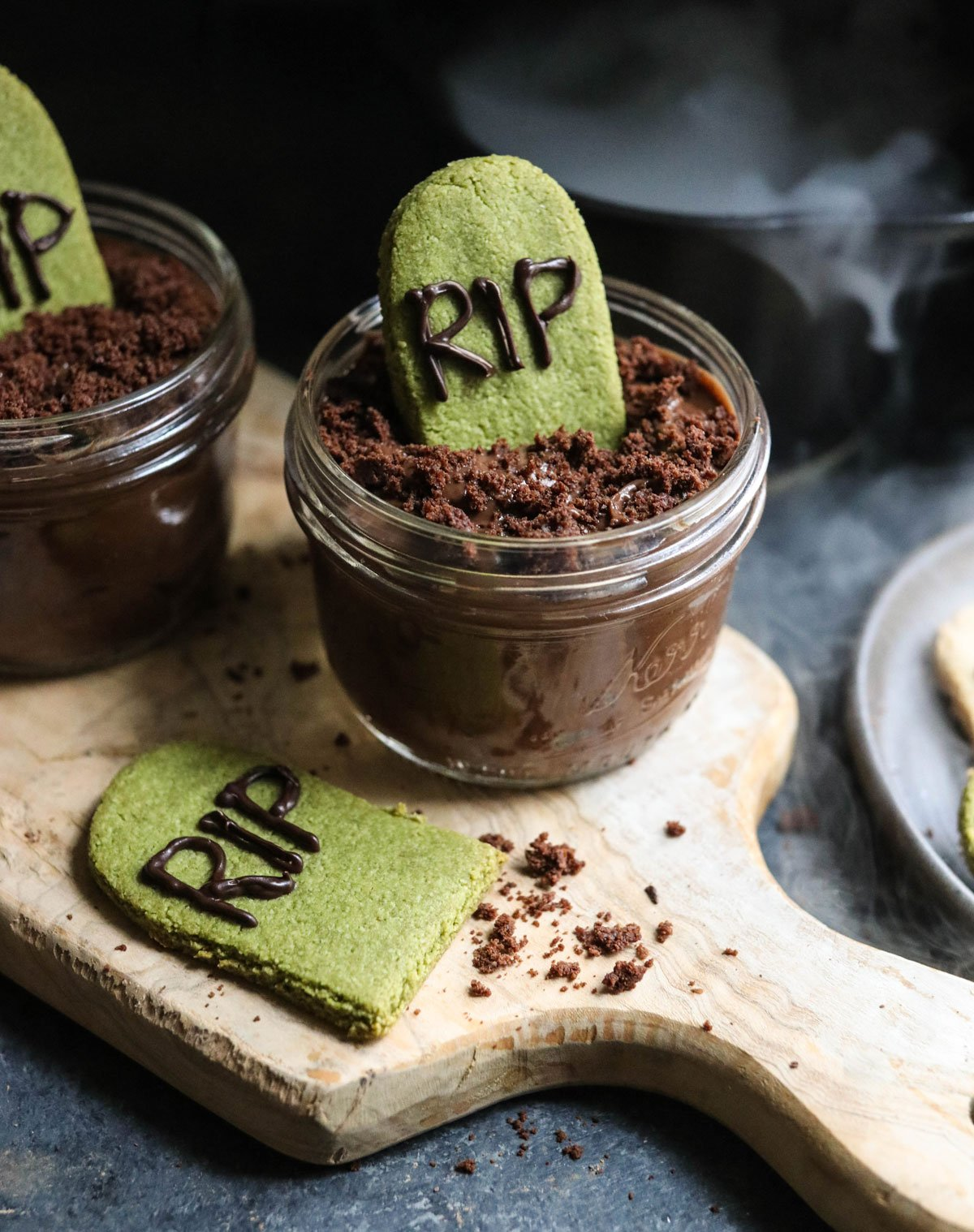 jar of chocolate pudding with tombstone cookie