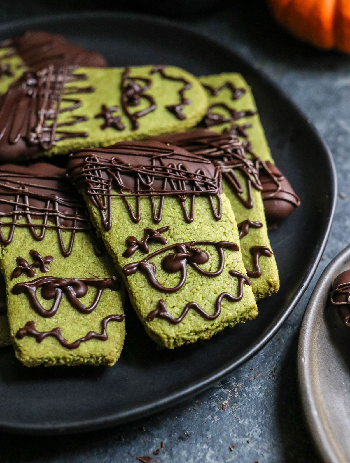 frankenstein cookies on black plate