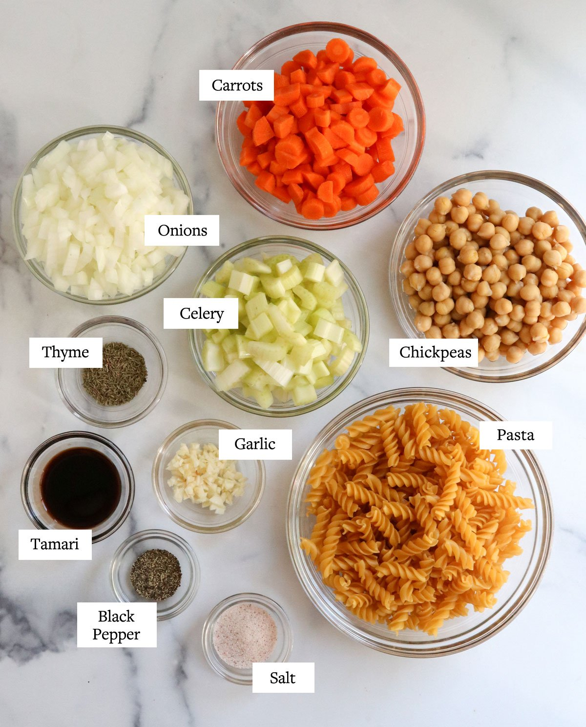 chickpea noodle soup ingredients in glass bowls