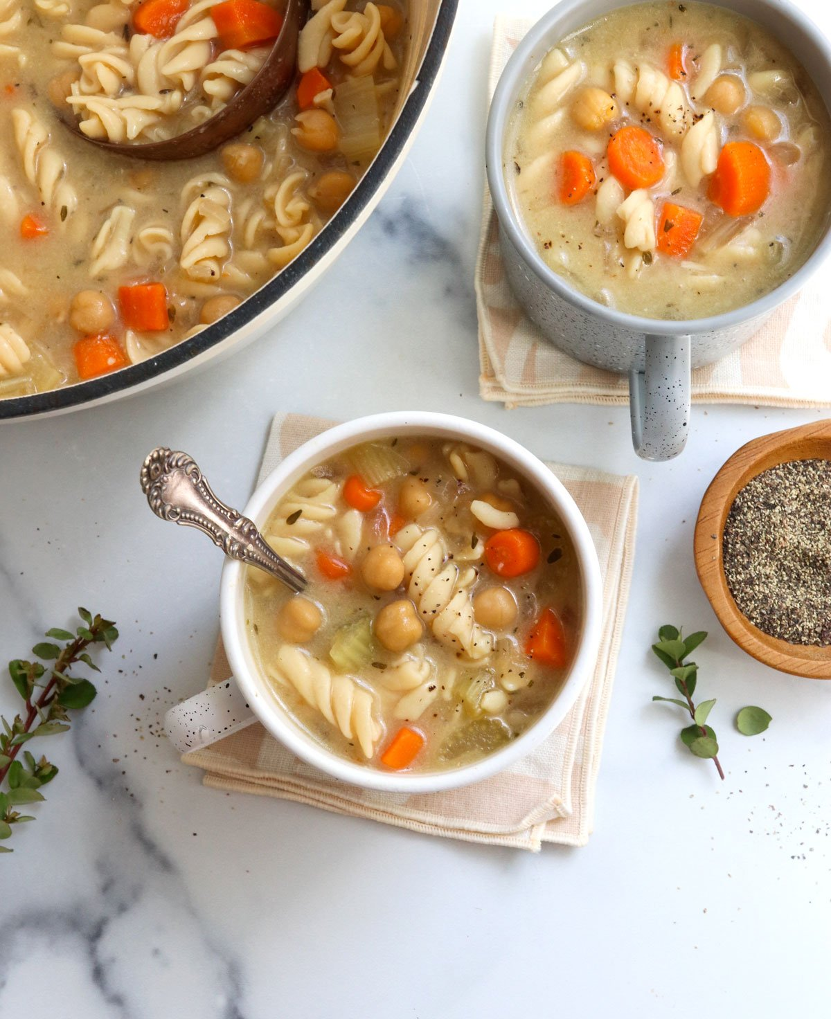 chickpea noodle soup overhead in mugs