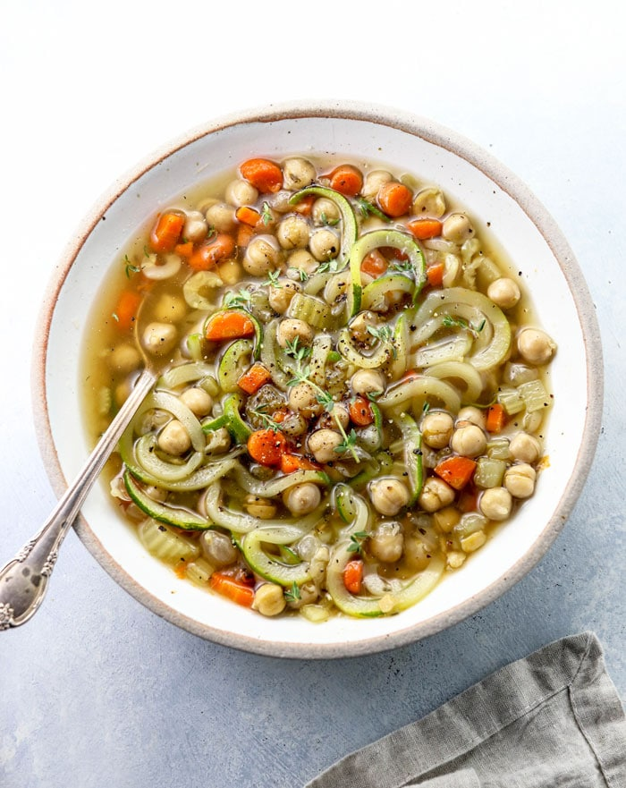 chickpea noodle soup in a white bowl