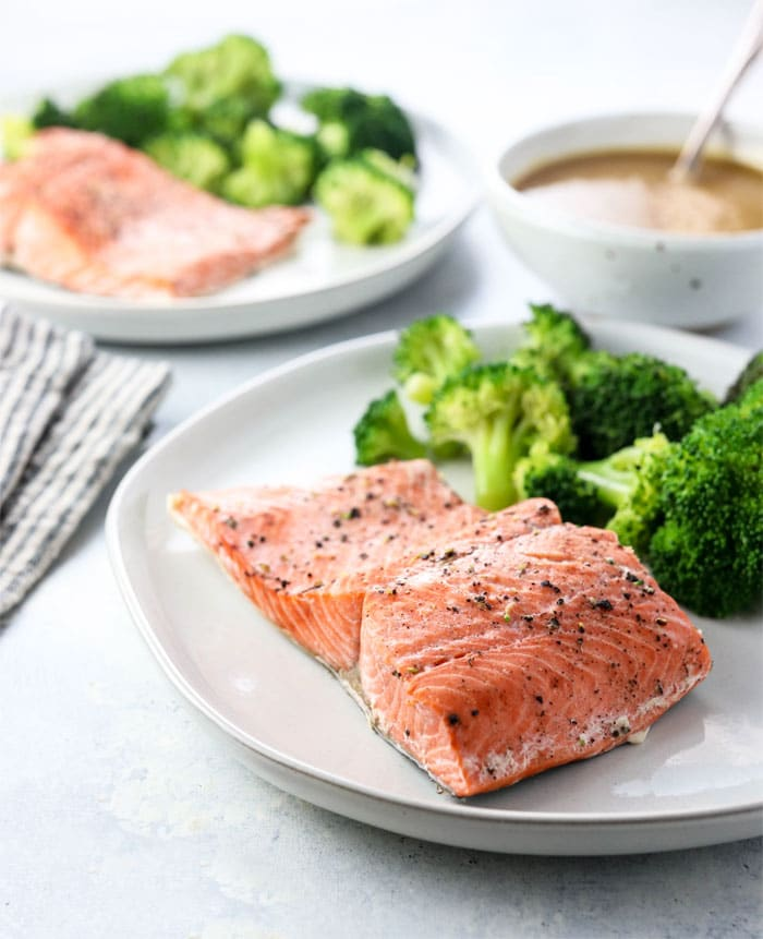 Here's my full-proof method for making INSTANT POT SALMON, using fresh or frozen. This is one of my favorite healthy go-to meals using a pressure cooker, that is ready in just 20 minutes! #instantpot #salmon