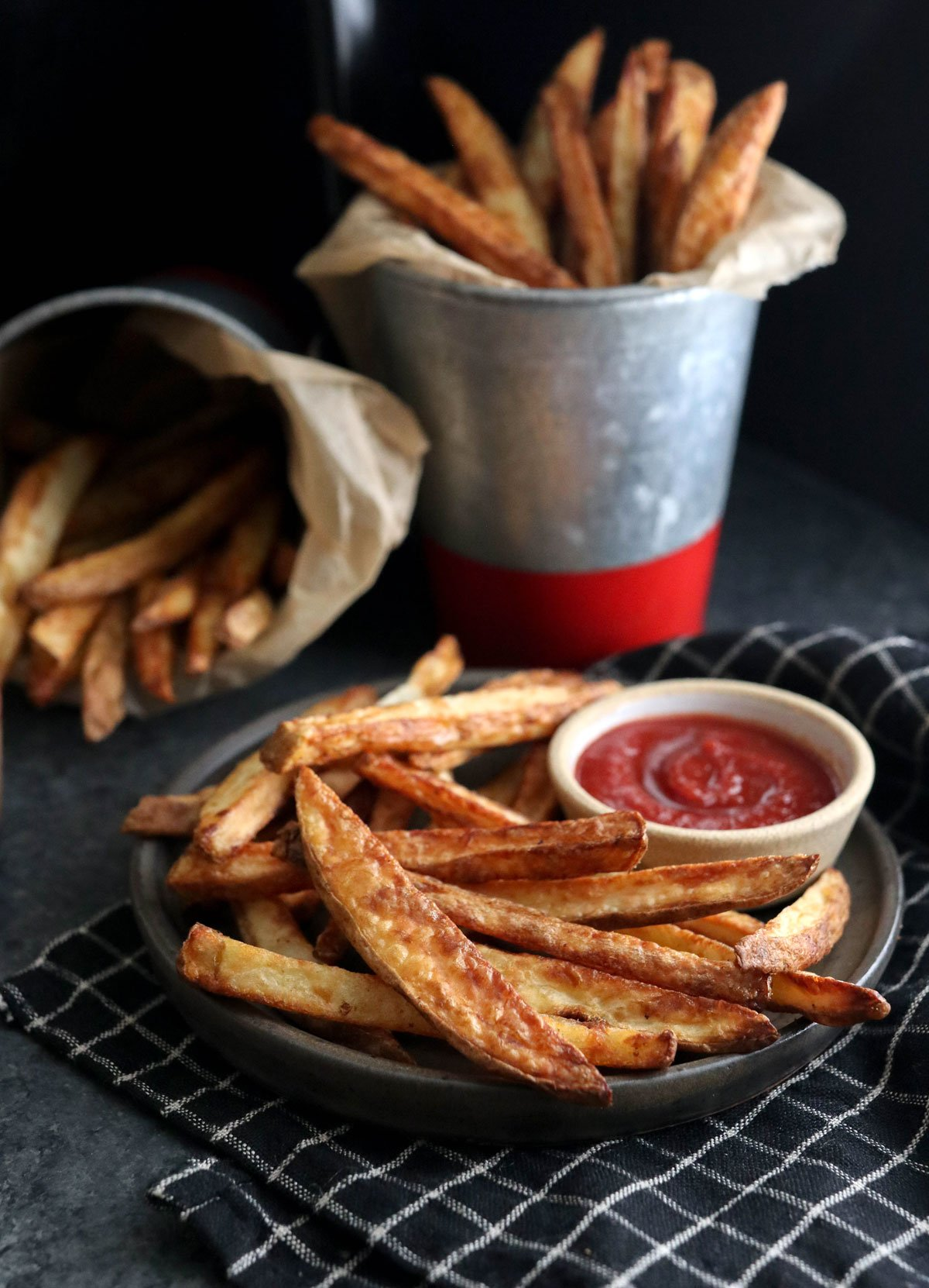 air fryer fries on black plate