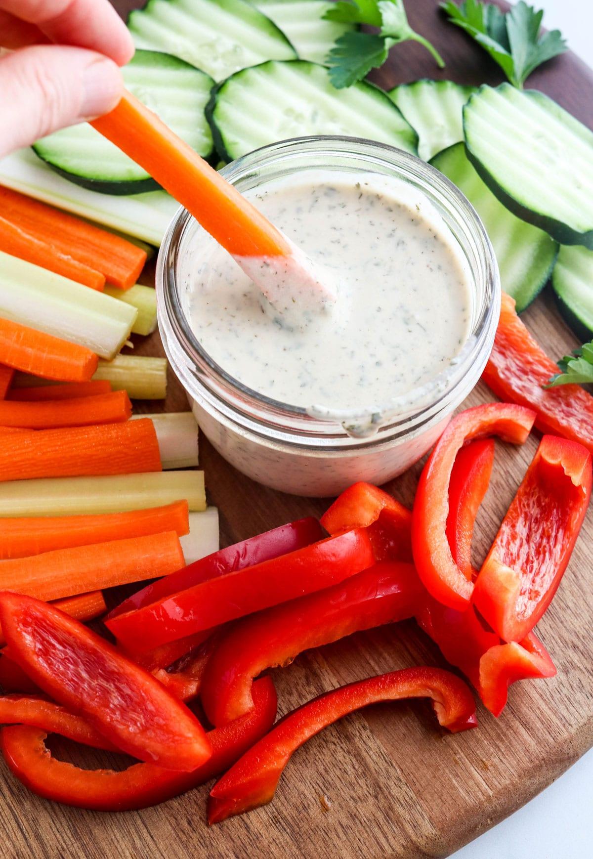 carrot dipped in vegan ranch dressing
