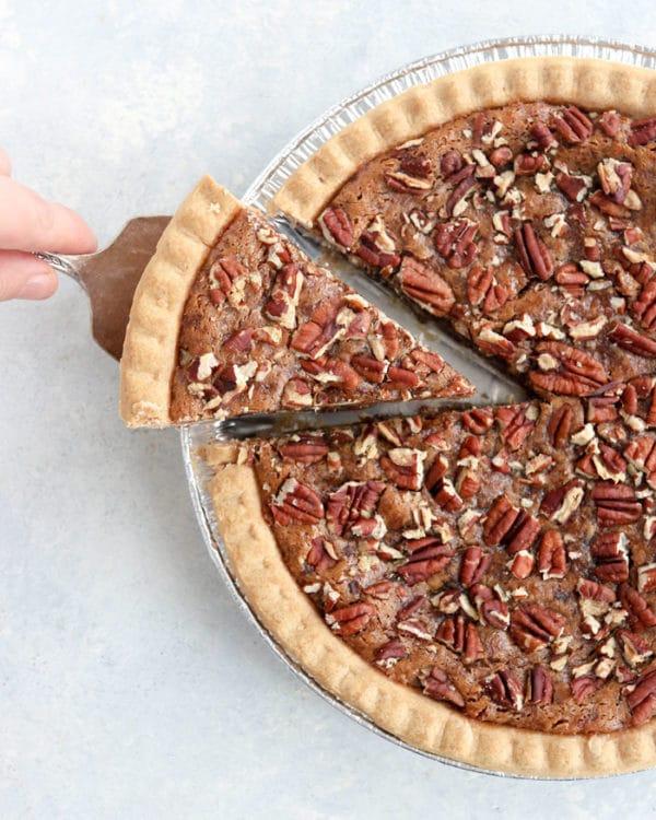 vegan pecan pie overhead with slice