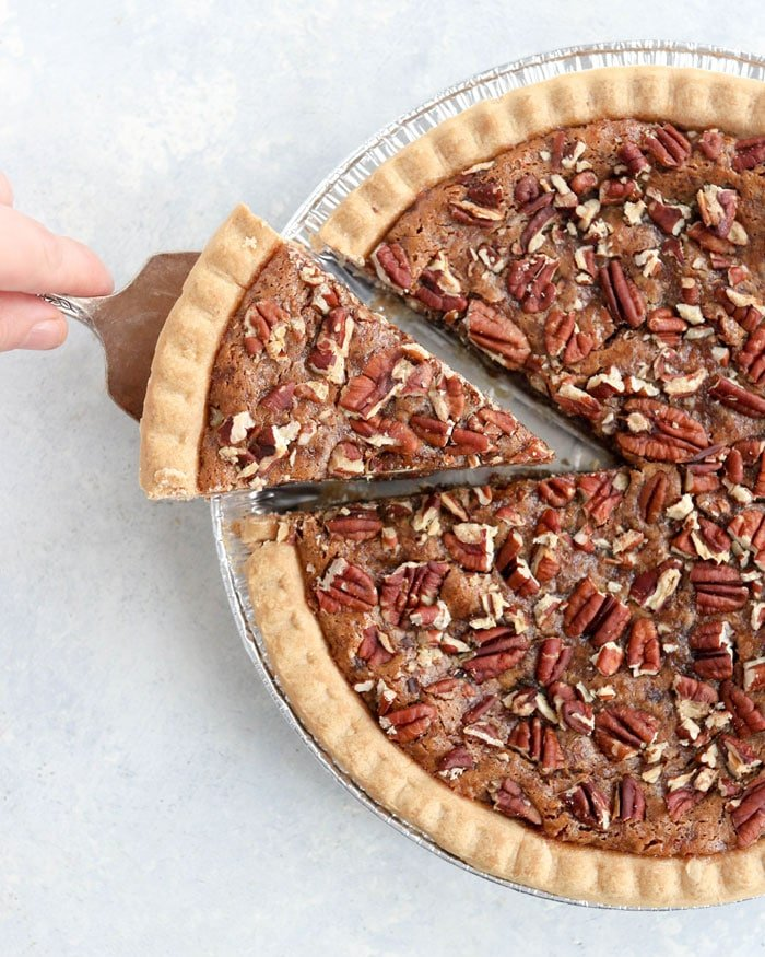 vegan pecan pie overhead with slice